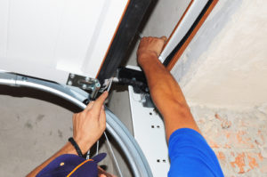 How do you replace a spring on a garage door