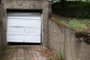 How do I lift my garage door with a broken spring