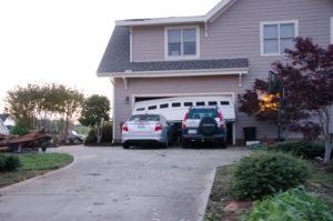 What happens if a garage door spring breaks