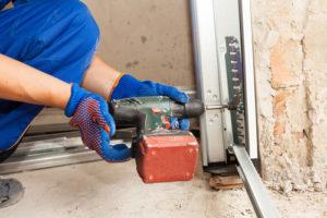 How do I install a garage door