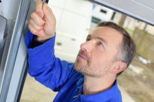 How to repair garage door panels